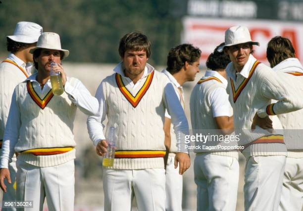 England cricketers Allan Lamb Mike Gatting and 12th man Neil Foster during a drinks break in the 2nd Test match between India and England at Feroz...