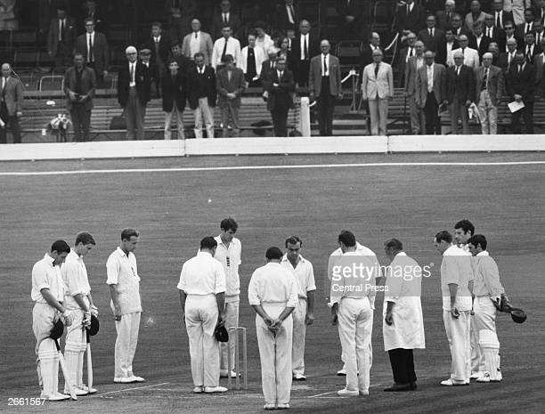 England cricketers and Australian batsman Bill Lawry and Ashley Mallett standing in tribute to batsman Joseph McCabe before the start of the fourth...
