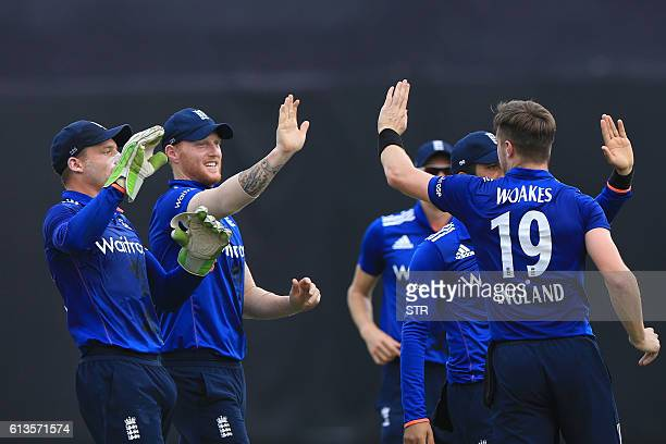 England cricketers congratulate Chris Woakes after the dismissal of the Bangladesh cricketer Imrul Kayes during the second one day international...