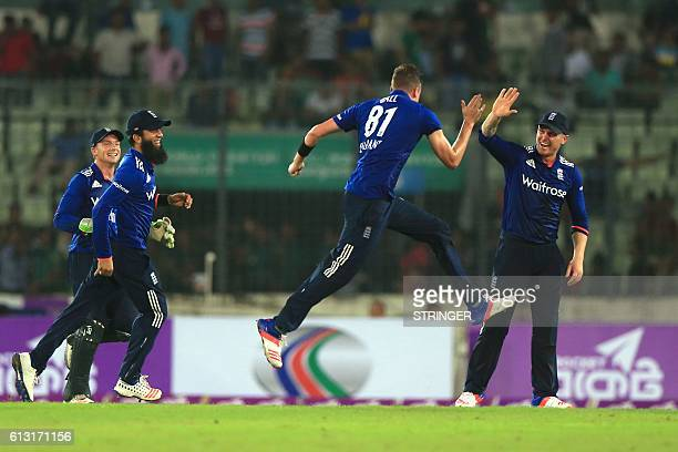 England cricketers congratulate Jake Ball after the dismissal of the Bangladesh cricketer Taskin Ahmed during the first one day international cricket...