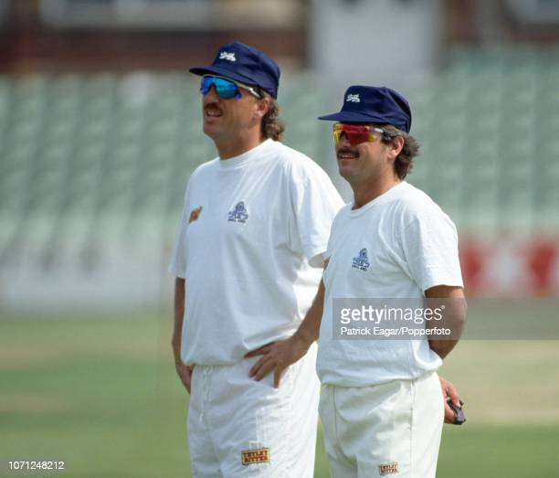 England cricketers Ian Botham and Allan Lamb during a training session at The Oval London during Pakistan's tour of England circa May 1992