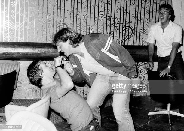 England cricketers Ian Botham and Geoff Cook watched by Derek Pringle enjoying a karaoke night in Dubai, United Arab Emirates, circa March 1983.