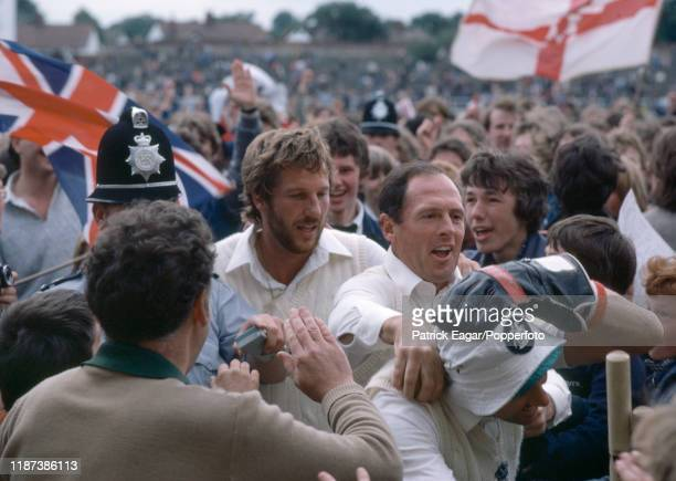 England cricketers Ian Botham, Geoffrey Boycott and wicketkeeper Bob Taylor make their way through the crowd after England win the 3rd Test match...