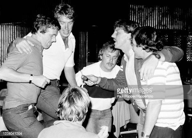 England cricketers including Ian Botham enjoying a Karaoke night in Dubai, United Arab Emirates, circa March 1983. Left-right: Geoff Cook, Derek...