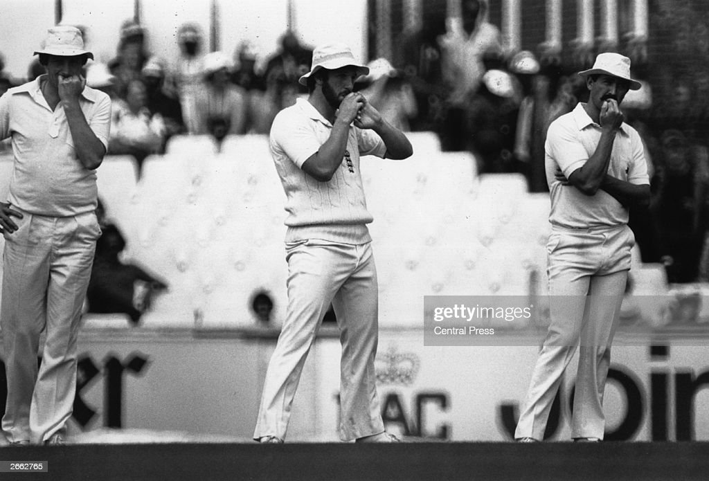 England cricketers John Emburey (left), Ian Botham (centre) and Graham Gooch biting their nails during a test match against the West Indies. Original Publication: People Disc - HD0164