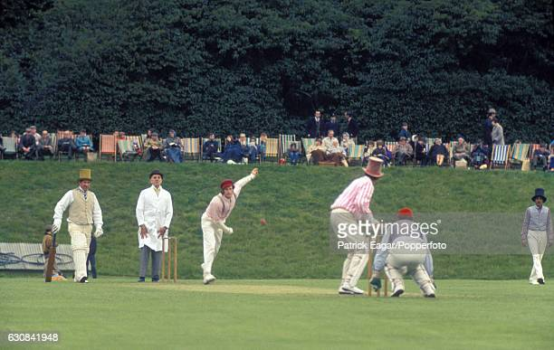 England cricketers John Snow and Ken Barrington take part in a demonstration game of Victorian cricket in vintage costume at Arundel Castle circa...