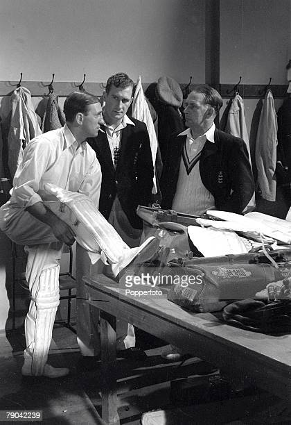 Len Hutton Jim Laker and Cyril Washbrook in a dressing room scene during the making of the film 'The Final Test'
