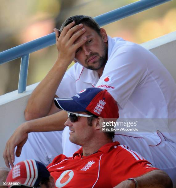England cricketers Steve Harmison and Andrew Strauss sit on the England dressing room balcony during the 5th Test match between West Indies and...