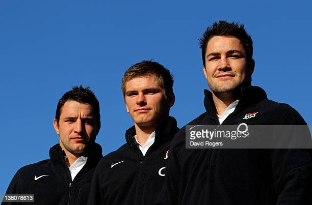 England debut caps Phil Dowson Owen Farrell and Brad Barritt pose for the camera during the England press conference at Pennyhill Park on February 2...