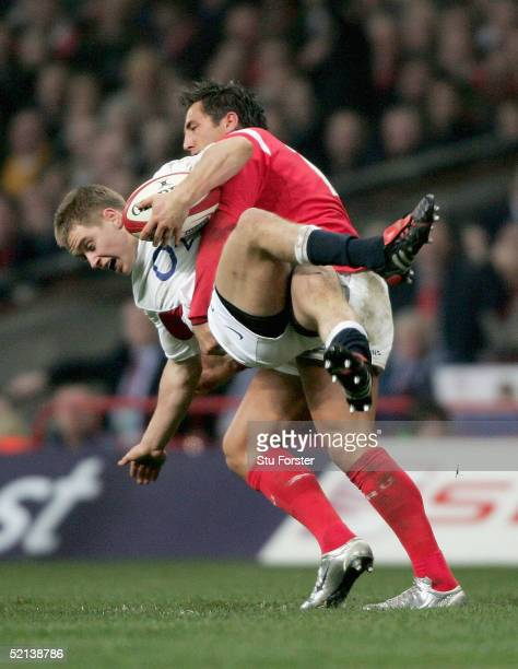 England debutant Mathew Tait is tackled by Gavin Henson during the RBS Six Nations game between Wales and England on February 5 2005 in Cardiff Wales