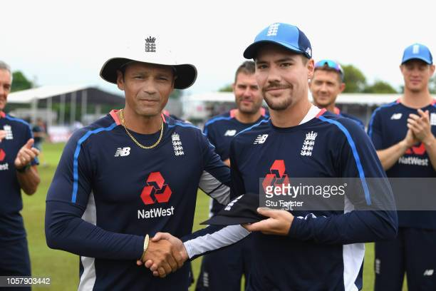 England debutant Rory Burns receives his cap off Mark Ramprakash before Day One of the First Test match between Sri Lanka and England at Galle...