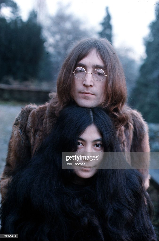 England, December 1968, Legendary musician and member of the Beatles, John Lennon, is pictured with Yoko Ono : News Photo