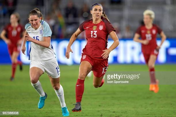 England defender Abby McManus and United States forward Alex Morgan chase a loose ball during the SheBelieves Cup match between USA and England on...