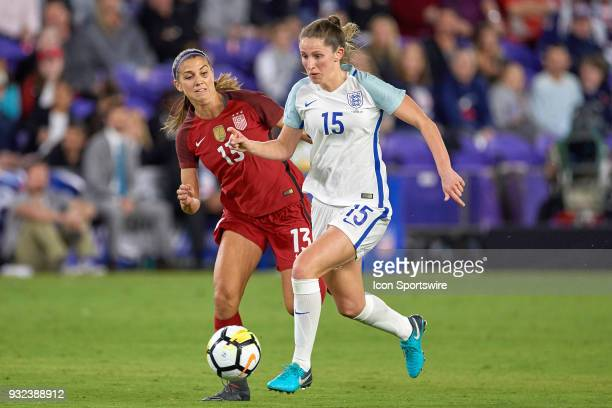 England defender Abby McManus battles with United States forward Alex Morgan for a loose ball during the SheBelieves Cup match between USA and...
