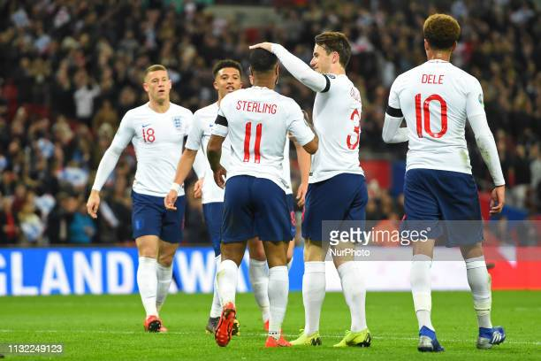England defender Ben Chilwell congratulates Raheem Sterling on his first of three goals during the UEFA European Championship Group A Qualifying...