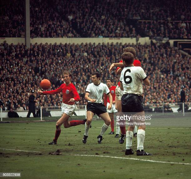 England defender Jack Charlton joins the attack as he moves past Franz Beckenbauer of West Germany at the far post during the FIFA World Cup Final...
