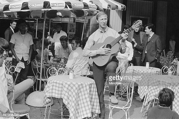 England defender Jack Charlton strumming a guitar as the team stroll around the Zona Rosa part of Mexico City during their shopping trip there 11th...