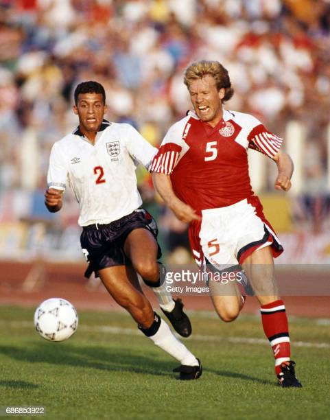 England defender Keith Curle is left trailing by Denmark player Henrik Anderson during the 1992 European Championships group match in Malmo Sweden on...