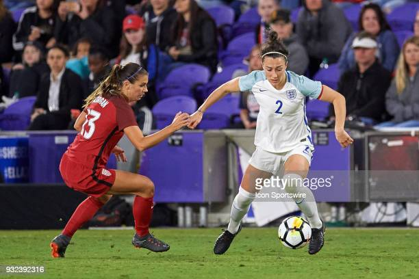 England defender Lucy Bronze battles with United States forward Alex Morgan during the SheBelieves Cup match between USA and England on March 07 at...