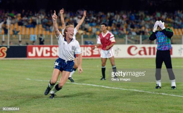 England defender Mark Wright celebrates after scoring the winning goal for England in their Group F match against Egypt in the 1990 FIFA World Cup at...