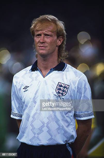 England defender Mark Wright pictured standing during the anthems before the 1990 FIFA World Cup quarterfinal game between Cameroon and England at...