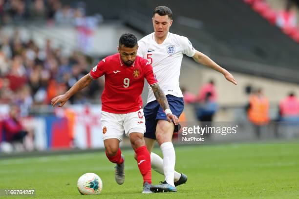 England defender Michael Keane battles with Bulgaria midfielder Wanderson during the UEFA Euro 202 Group A Qualifying match between England and...