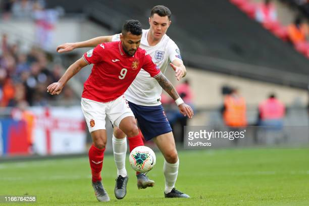 England defender Michael Keane puts pressure on Bulgaria midfielder Wanderson during the UEFA Euro 202 Group A Qualifying match between England and...