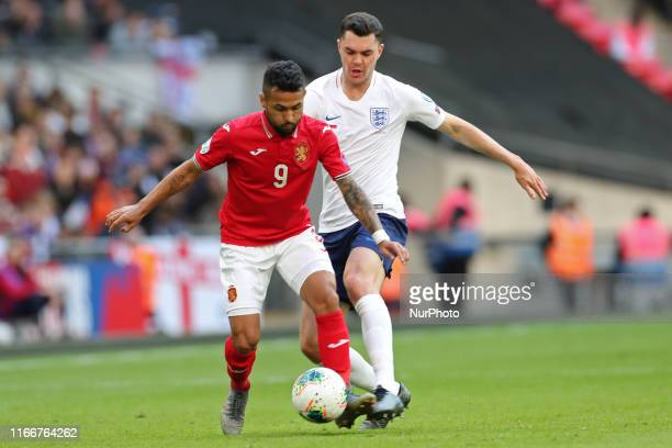 England defender Michael Keane puts pressure on Bulgaria midfielder Wanderson during the UEFA Euro 2020 Group A Qualifying match between England and...