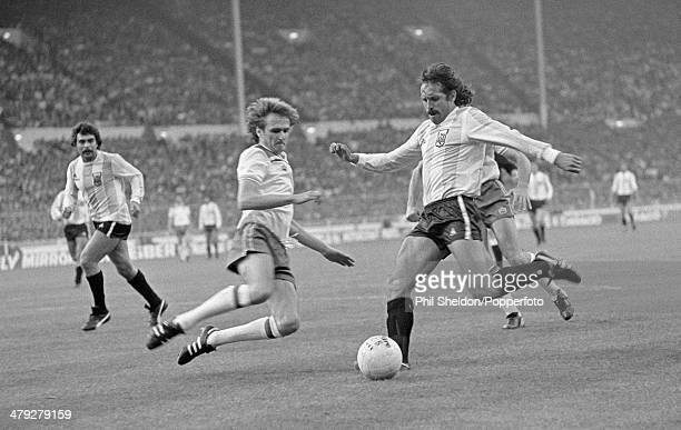 England defender Phil Thompson slides in to tackle Argentina striker Leopoldo Luque during the International friendly match at Wembley Stadium in...