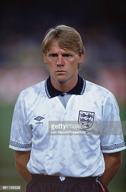 England defender Stuart Pearce pictured standing during the anthems before the 1990 FIFA World Cup quarterfinal game between Cameroon and England at...