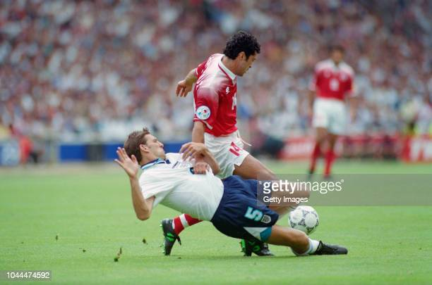England defender Tony Adams challenges Switzerland player Kubilay Turkyilmaz during the game against Switzerland in the 1996 European Championships...
