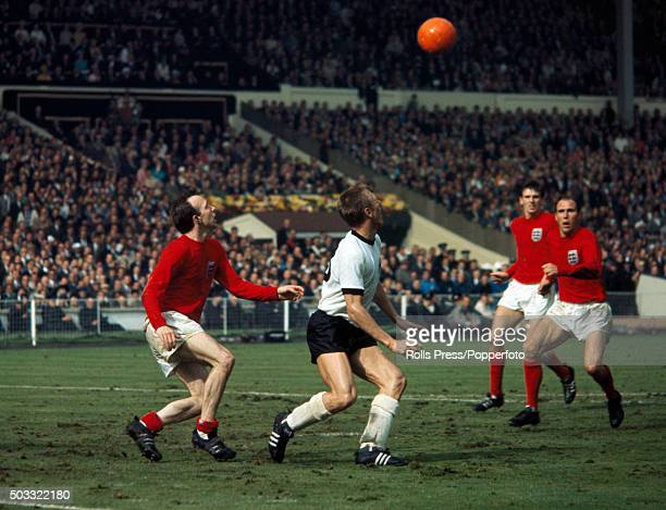 England defenders Nobby Stiles Martin Peters and Ray Wilson converge on West Germany striker Siegfried Held during the FIFA World Cup Final between...