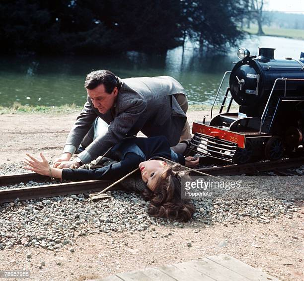 """England Diana Rigg and Patrick McNee are pictured in a scene from the television series """"The Avengers"""" where McNee's character John Steed attempts to..."""
