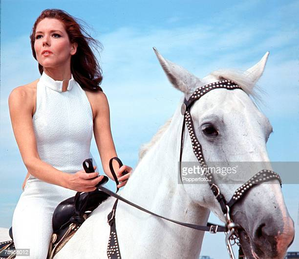 "England Diana Rigg is pictured riding a horse in her role as Emma Peel in the television series ""The Avengers"""