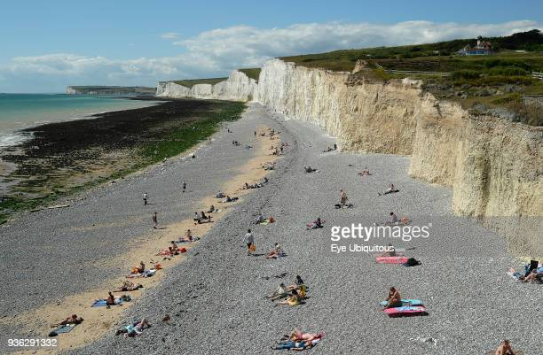 England East Sussex Birling Gap View along pebble beach with the Seven Sisters white chalk cliffs