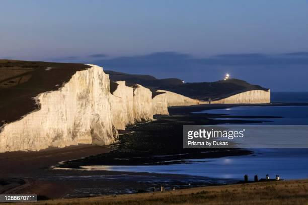 England, East Sussex, Eastbourne, South Downs, The Seven Sisters Chalk Cliffs and English Channel at Night.