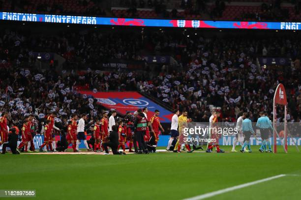 England emerge onto the pitch for their 1000th match before the UEFA Euro 2020 qualifier match between England and Montenegro at Wembley Stadium...