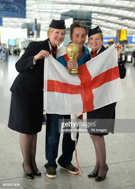England fan Dave Raby from Gillingham poses with BA Cabin Crew Kimberley Lauf and Jane Lynch in departures at Terminal 5 at Heathrow before boarding...