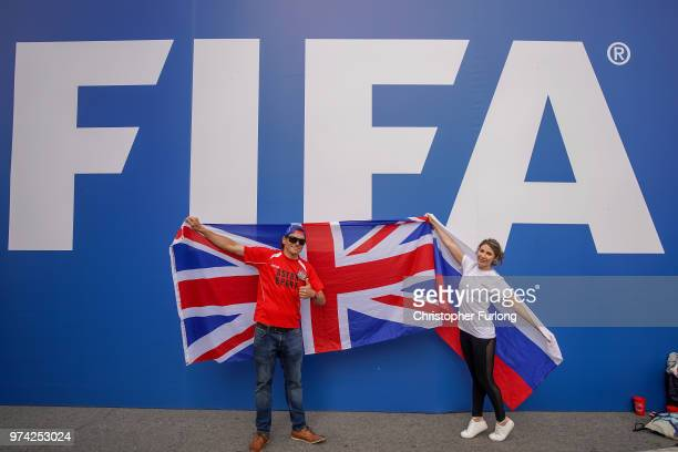 England fan Richard Pearce who runs a football academy in Russia poses with a Russian fan at the official FIFA Fan Fest at Moscow State University to...