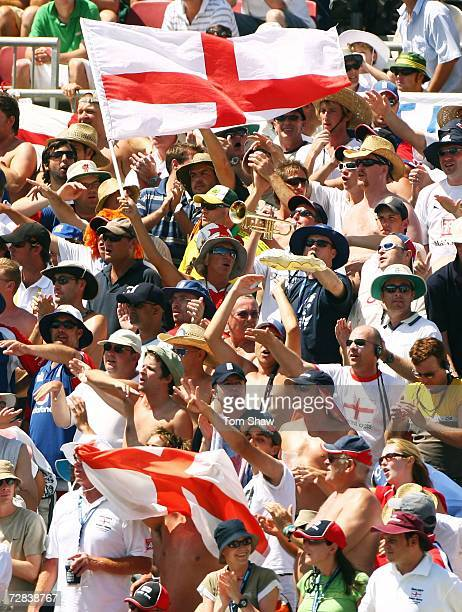 England fan Victor Flowers and Bill Cooper the Barmy Army trumpeter lead the Barmy Army in song during day four of the third Ashes Test Match between...