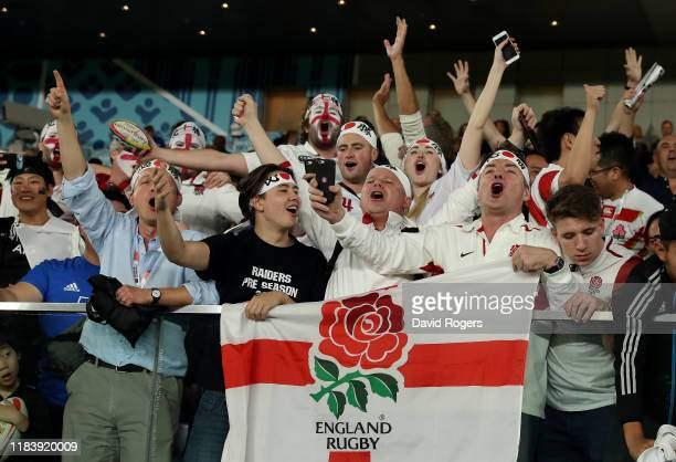 England fans celebrate after their victory during the Rugby World Cup 2019 SemiFinal match between England and New Zealand at International Stadium...