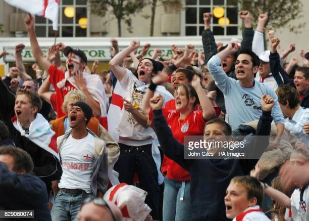 England fans celebrate after Wayne Rooney scores against Croatia in the Euro 2004 group B match being shown on a big screen in Leeds city centre