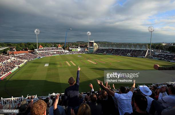 England fans celebrate as England laim the wicket of Colin Munro of New Zealand during the 3rd Natwest Series ODI match between England and New...