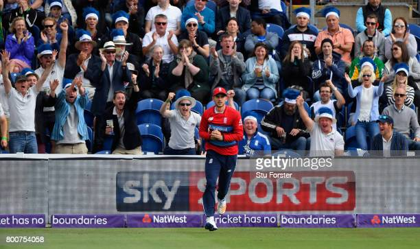 England fans celebrate as fielder Aex Hales takes a catch to dismiss Chris Morris during the 3rd NatWest T20 International between England and South...