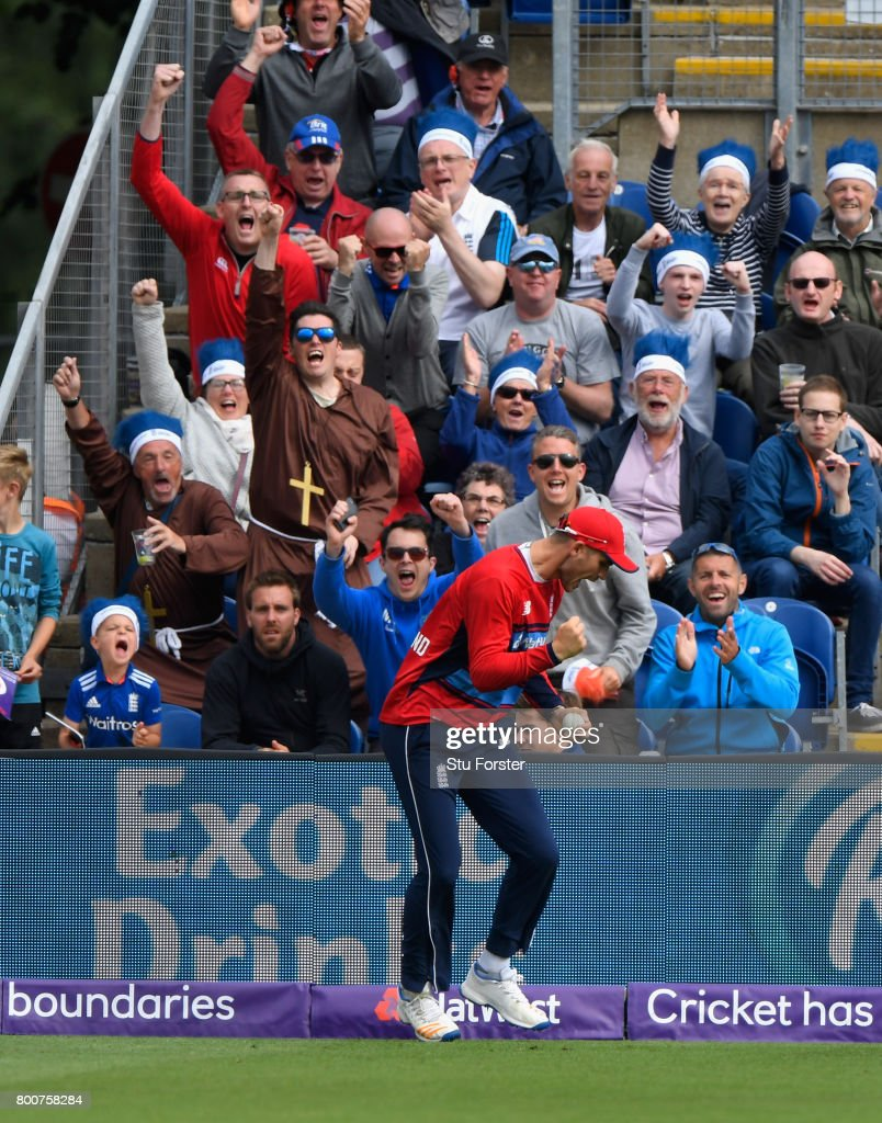 England fans celebrate as fielder Aex Hales takes a catch to dismiss AB de Villiers during the 3rd NatWest T20 International between England and South Africa at SWALEC Stadium on June 25, 2017 in Cardiff, Wales.