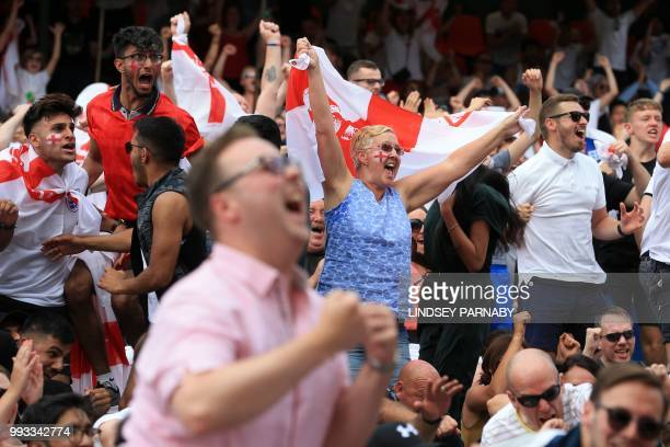 England fans celebrate as Harry Maguire scores England's opening goal as they watch the Russia 2018 World Cup quarterfinal football match between...