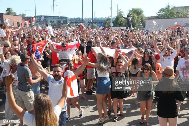 England fans celebrate at full time as England take on Sweden in the World Cup quarter finals at Ashton Gate World Cup fans village at the Bristol...