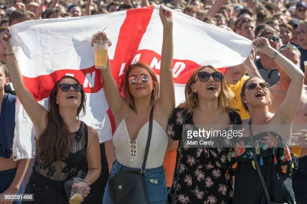 England fans celebrate at full time as England win 20 against Sweden as they watch the World Cup quarter finals at Ashton Gate World Cup fans village...