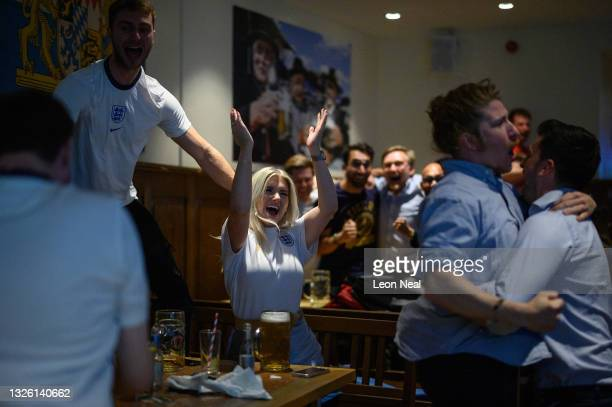 England fans celebrate during a live broadcast at the Bierschenke bar of the match between England and Germany to decide who gets through to the Euro...