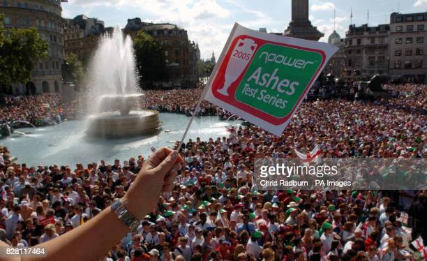 England fans celebrate during the Ashes victory parade in Trafalgar Square, London, Tuesday September 13, 2005. England regained the Ashes yesterday...